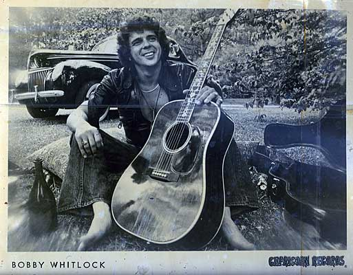 Pic from Grants Lounge wall of Bobby Whitlock and the car in the background is the car Twiggs traded Gregg for Duanes guitar.